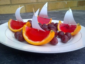 Jelly boats and fruit on a plate