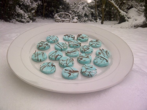 Peppermint creams on a plate in the snow