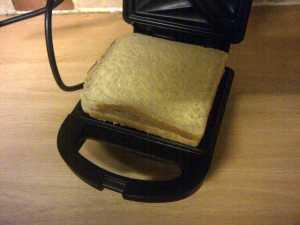 Apple sandwich in toaster