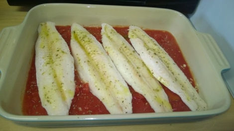 Fish and tomatoes in dish