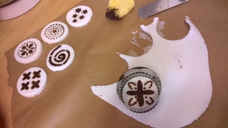Cutting stencilled fondant out