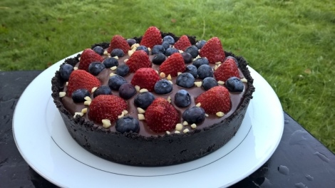 Chocolate tart with strawberries and blueberries